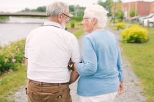 elderly couple communicating